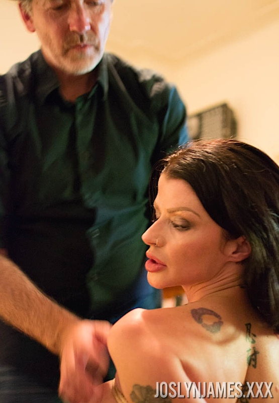 Tattooed brunette Joslyn James submits to being tied up with rope
