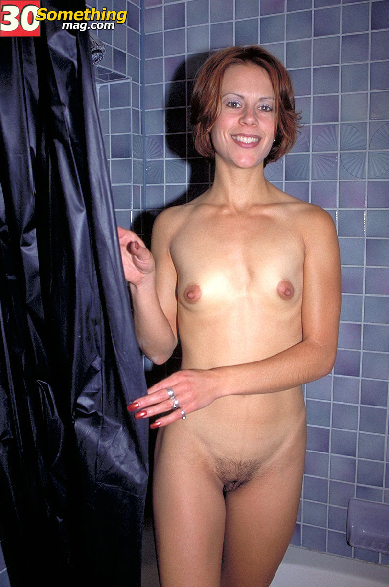Over 40 lady bares her tiny tits prior to getting in the shower stall