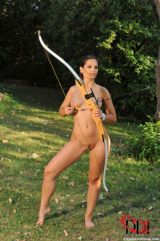 Naked girl shooting bow