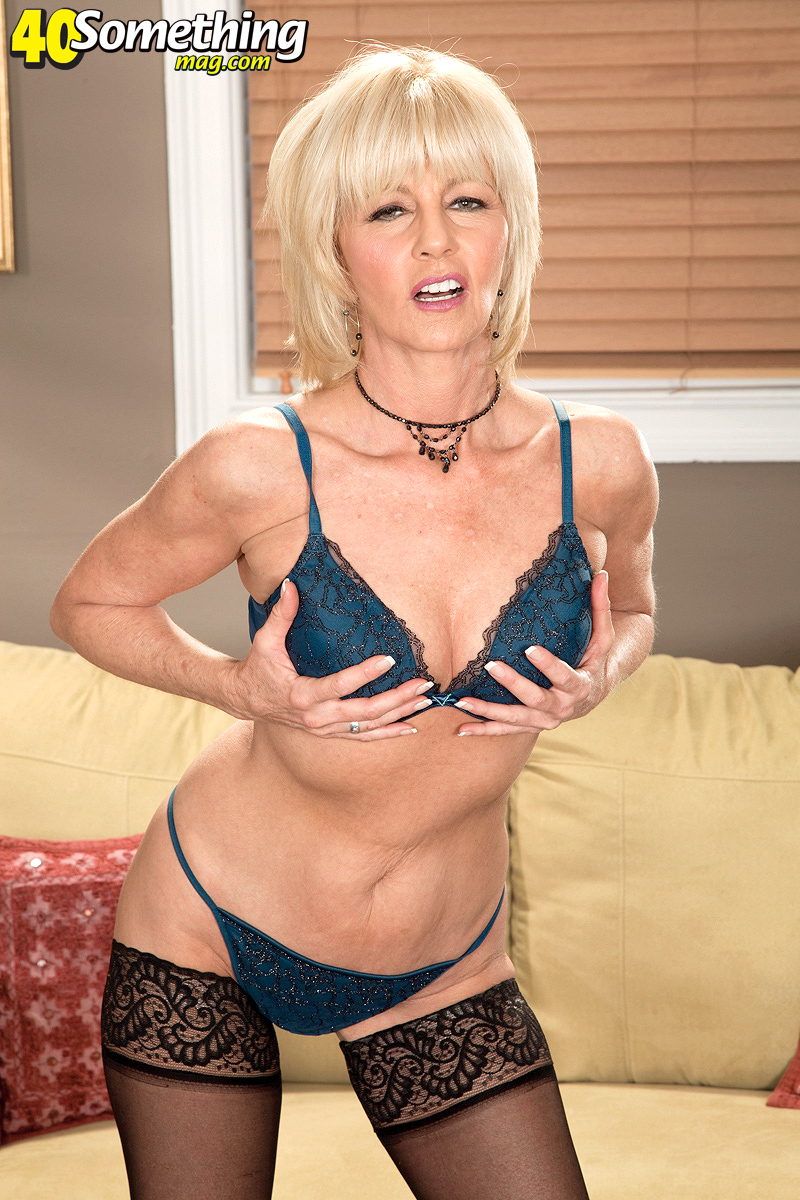 middle-aged lady eve bannon uncovers small tits as she removes bra