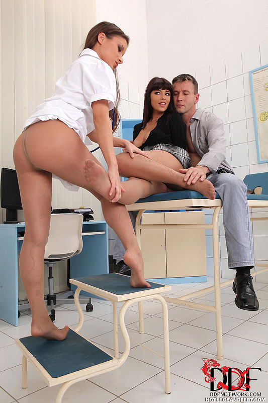 Leggy pantyhose clad chicks Anita Berlusconi  Ava Dalush giving footjob