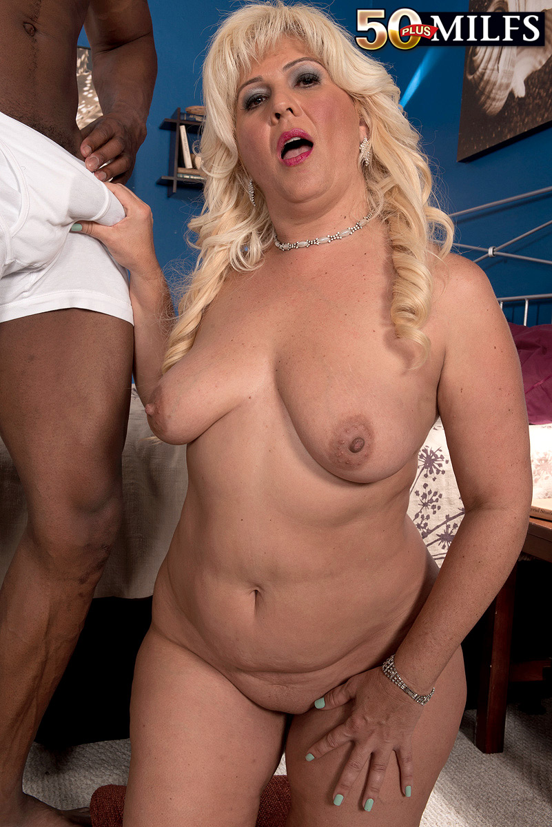 Mature BBW Lori Suarez is stripped naked by her younger