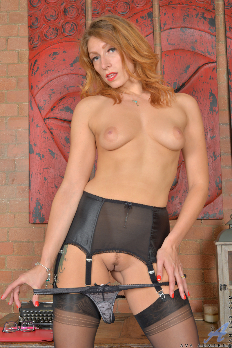 mature redhead starlet wearing glasses spreads her wet cunt wide