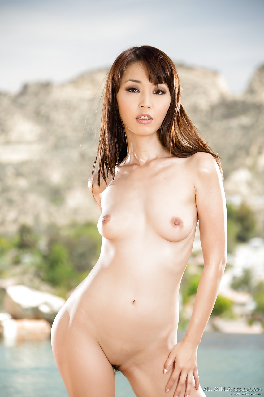 Asian babe Marica Hase freeing small tits from bikini outdoors by ocean