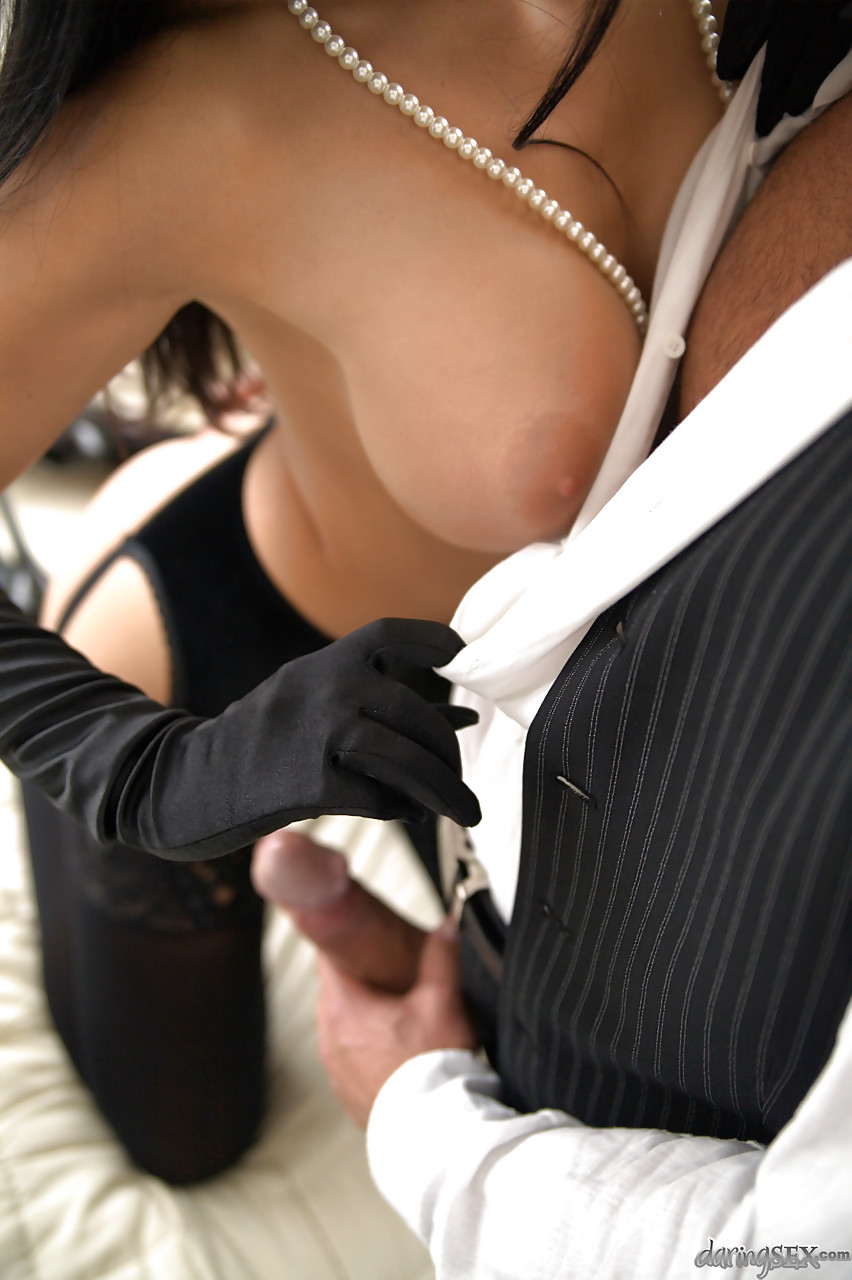 ... Dark haired stocking and long glove adorned pornstar flaunting large  tits ...