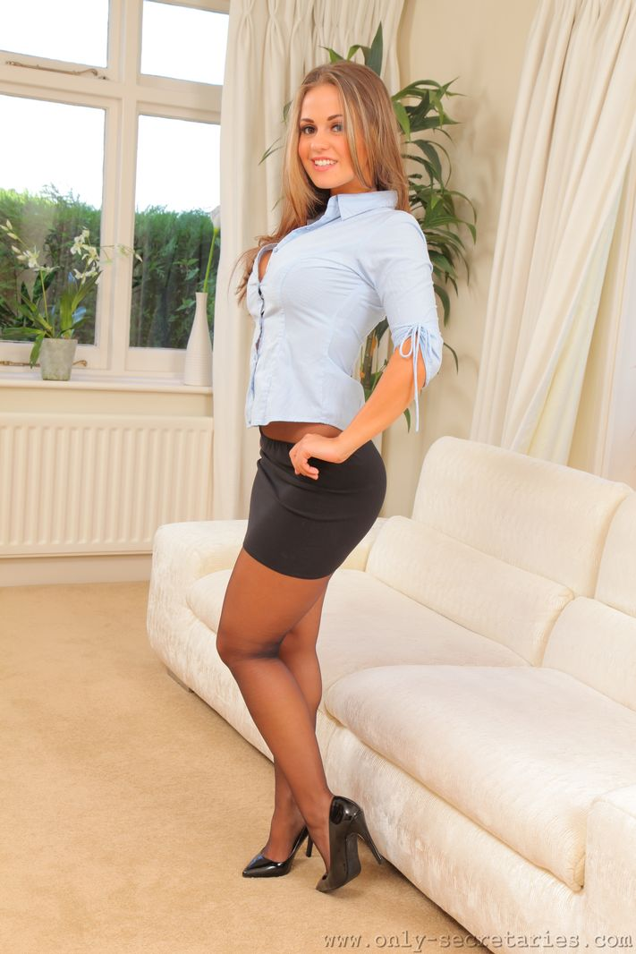 Blonde secretary Emma K uncovers her great tits in pantyhose and pumps