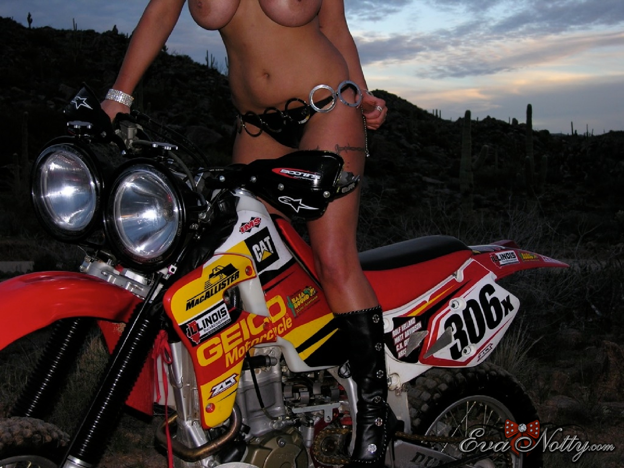 Chesty MILF Eva Notty pretends to be a biker posing topless with a hot machine