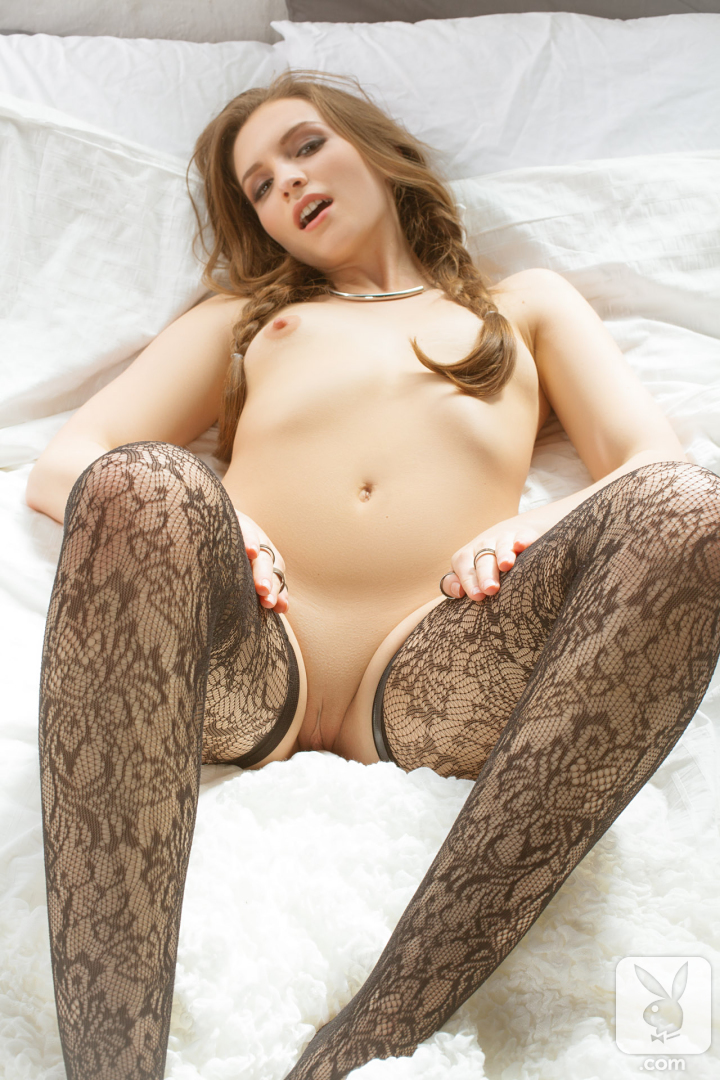 Erotic model mandy kay in pigtails black stockings displaying her sexy ass