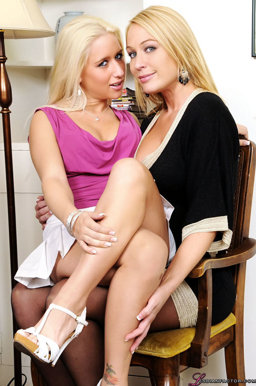 Blonde lesbians kiss on the mouth while humping on a chair