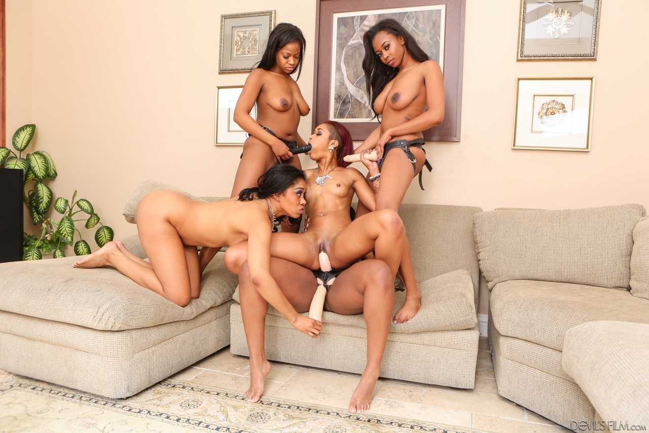 Group of girls whip out their arsenal of sex toys during ebony lesbian orgy