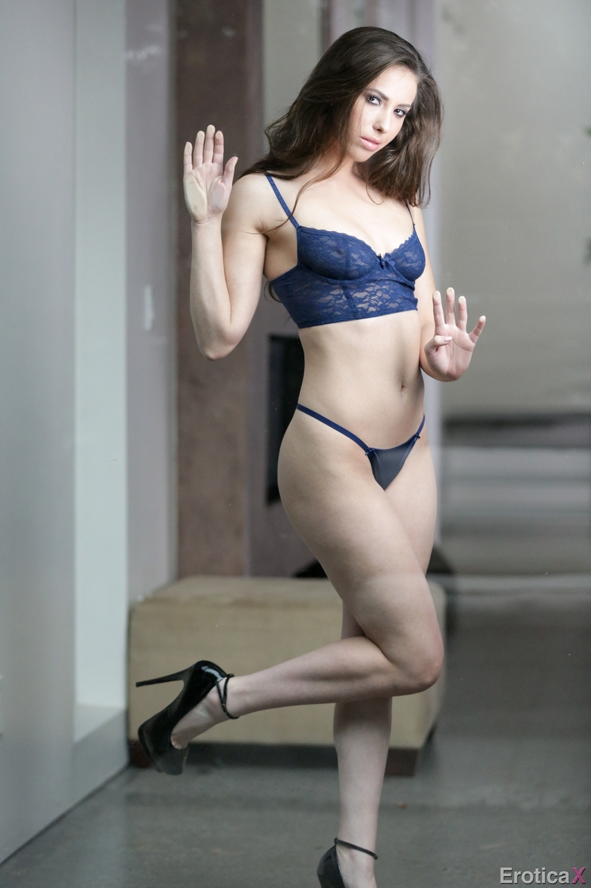 Sexy MILF Casey Calvert removes lingerie to stand naked in ankle strap heels