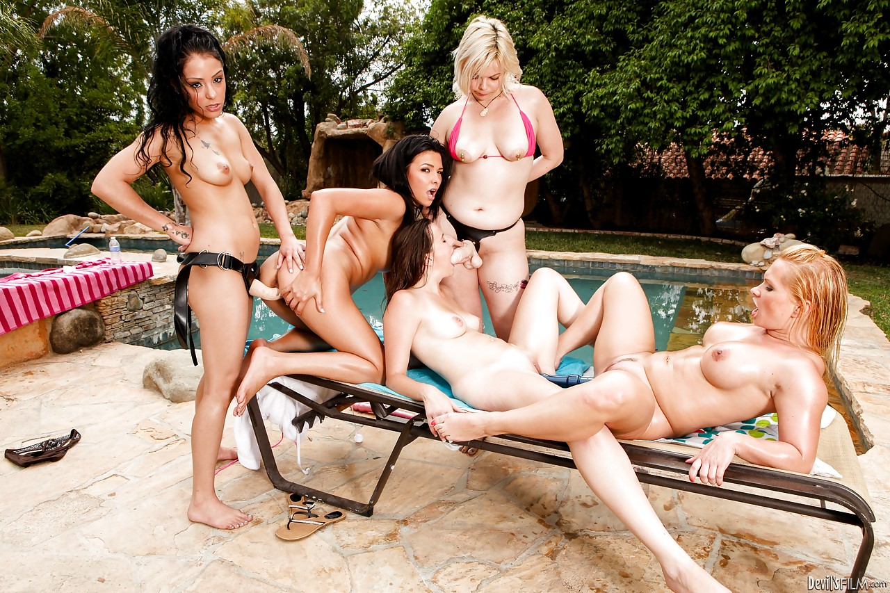 5 girls take turns doing each other with strapons beside swimming pool