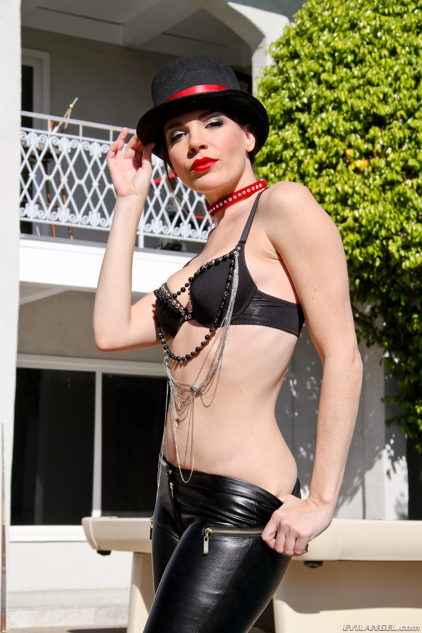 Hot MILF Dana Dearmond grabs her ass after pulling down leather pants by pool