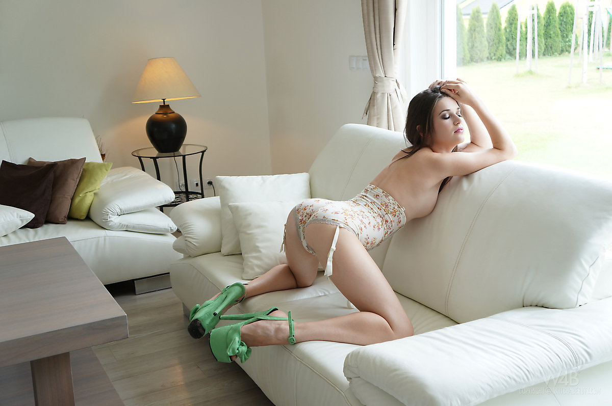 Beautiful girl Serena strikes great clothed and nude poses in solo action