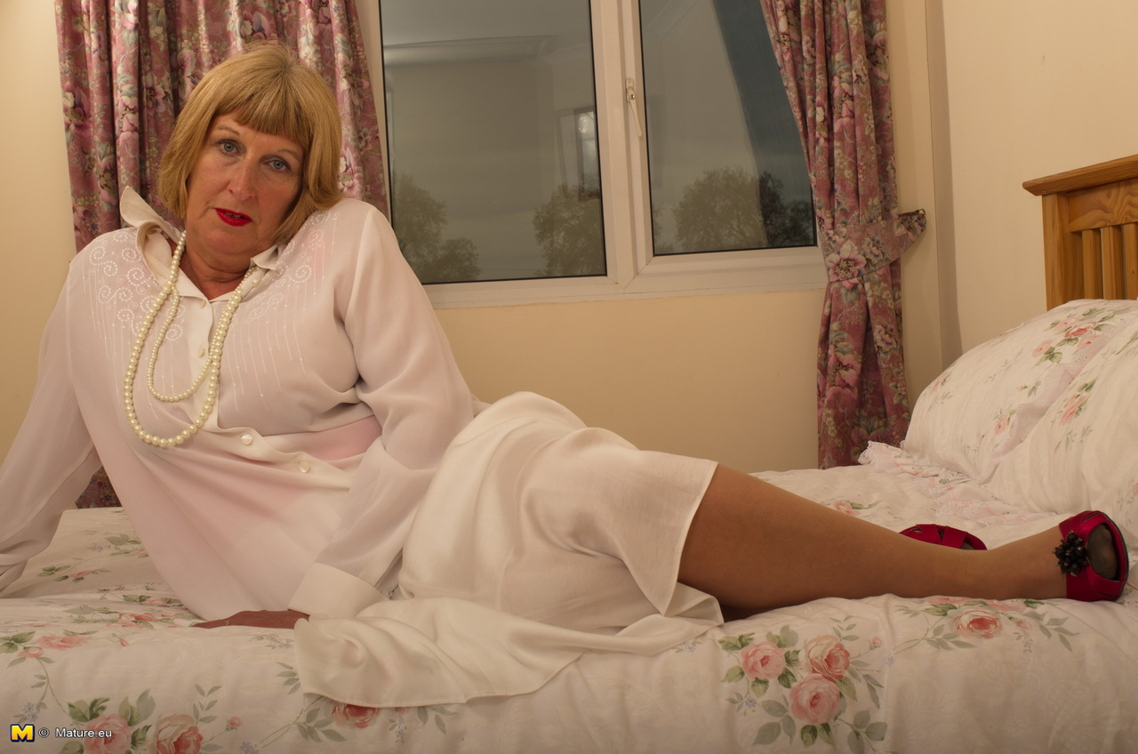 horny old granny shyly removes her sunday best to show her garter