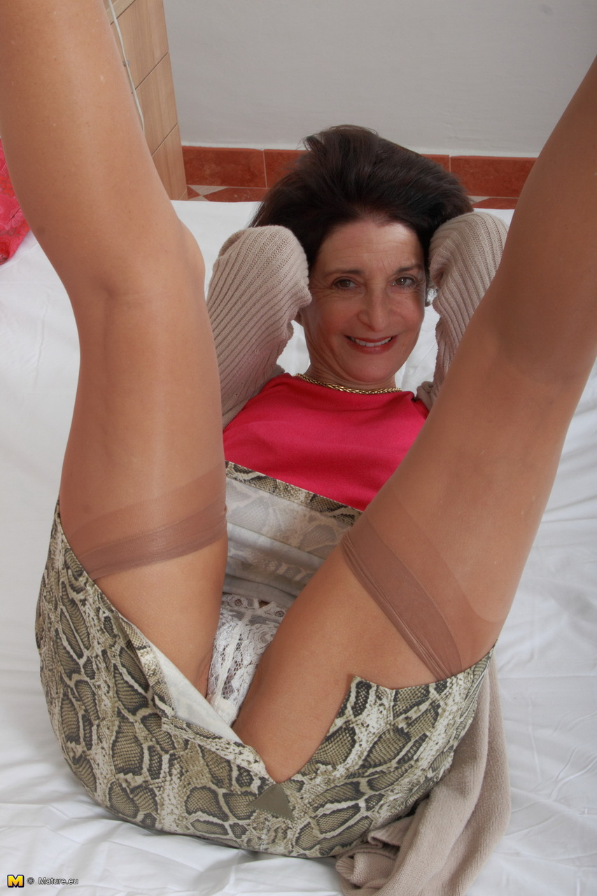 Horny Grandmother Plays With Her Pussy Right Thru Her Lace Underwear