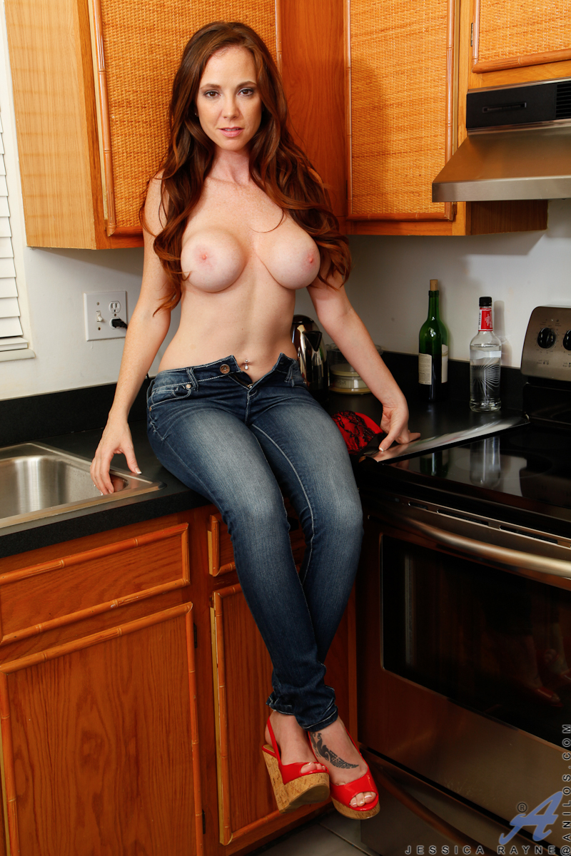 milf with belly piercing and red hair revealing big boobs in kitchen