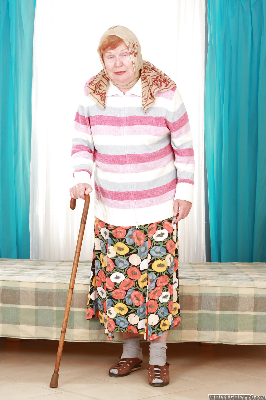 fat old granny alice with cane posing fully clothed in long skirt