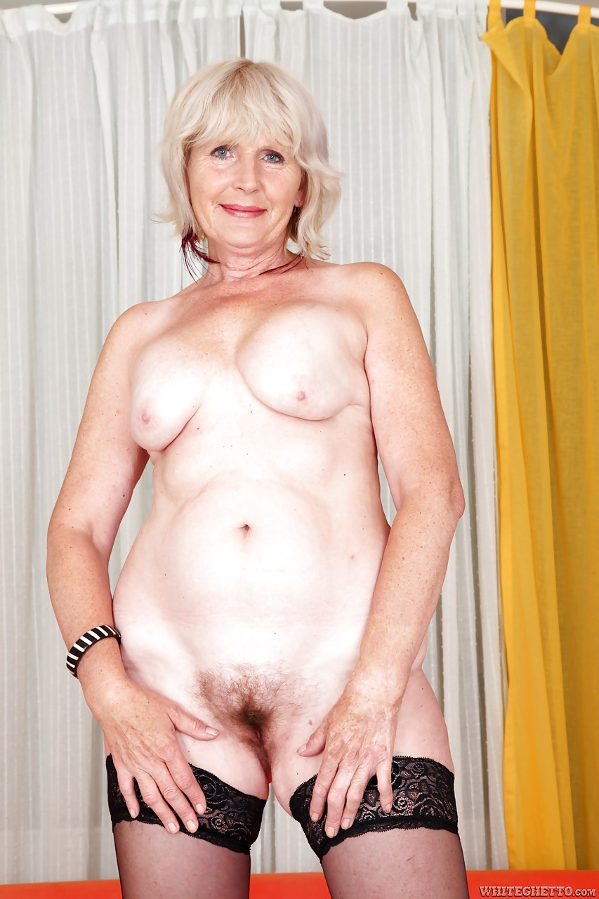 Hairy granny spreading