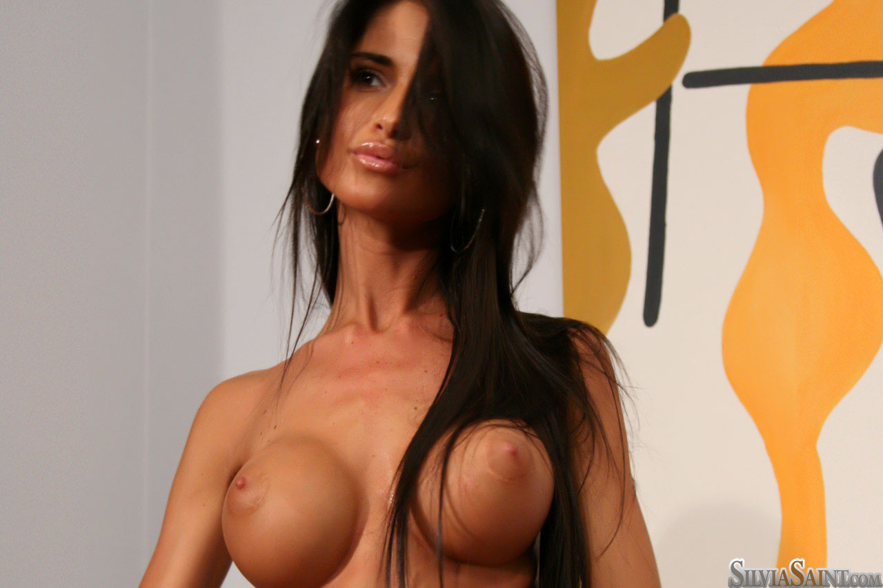 Tall female Nessa Devil shows her big tits while modeling in the nude