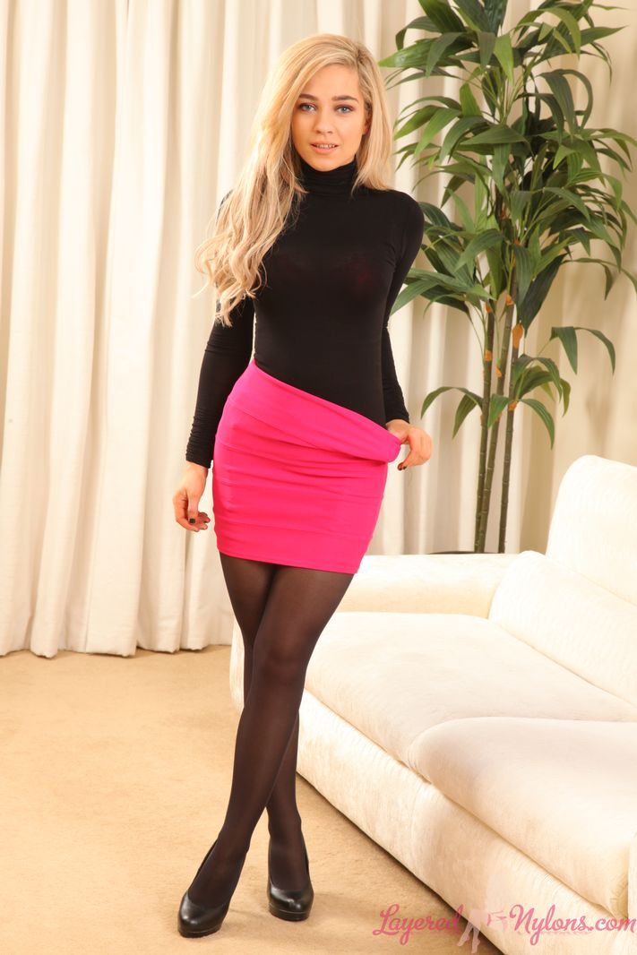 Tall blonde Marie Jones removes pink skirt in layered nylons and heels