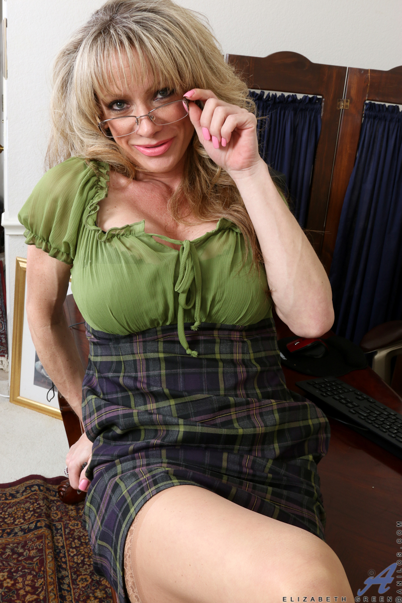 older mature blonde in glasses and stockings exposing big tits
