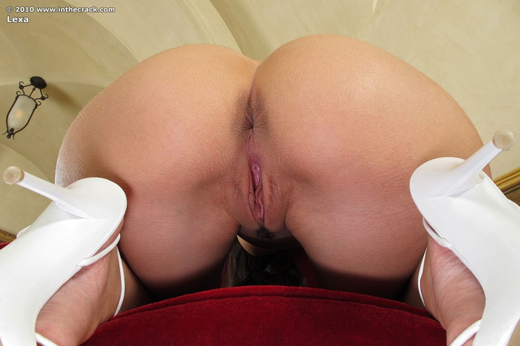 Bare legged girl Lexa flashes a no panty upskirt before toying her nice pussy