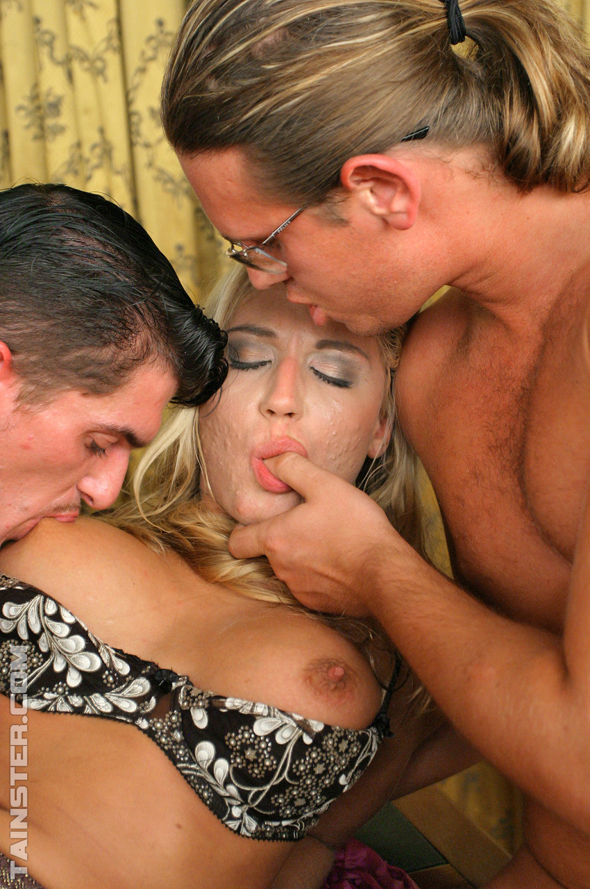 Horny blonde slag gets fucked and pissed on while clothed in kinky threesome