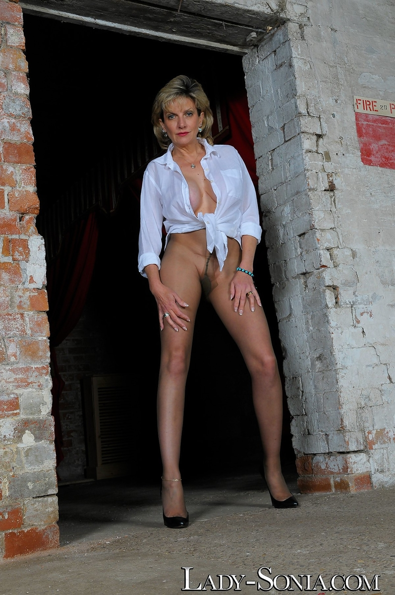 hot mature lady sonia roams outside bare assed in sheer shredded