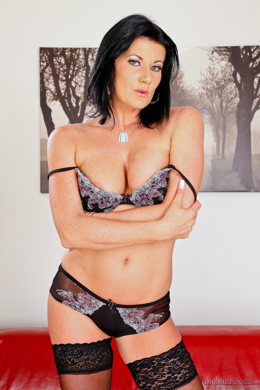 Dark haired MILF sheds tight skirt to pose in lace lingerie  black stockings