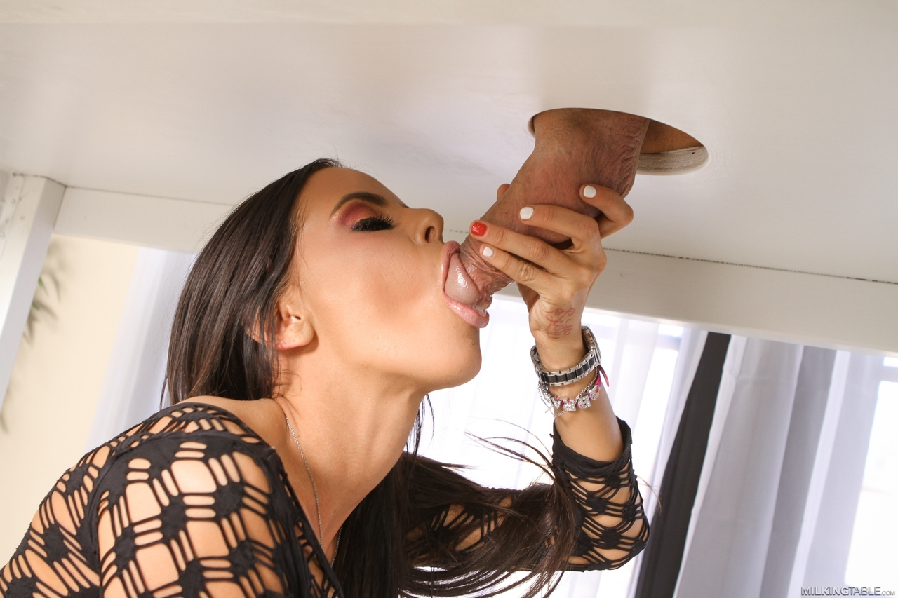Marie milking a huge cock under a glory hole table