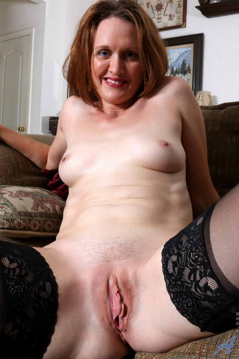 middle aged dame shows off her shaved pussy after doffing black bra