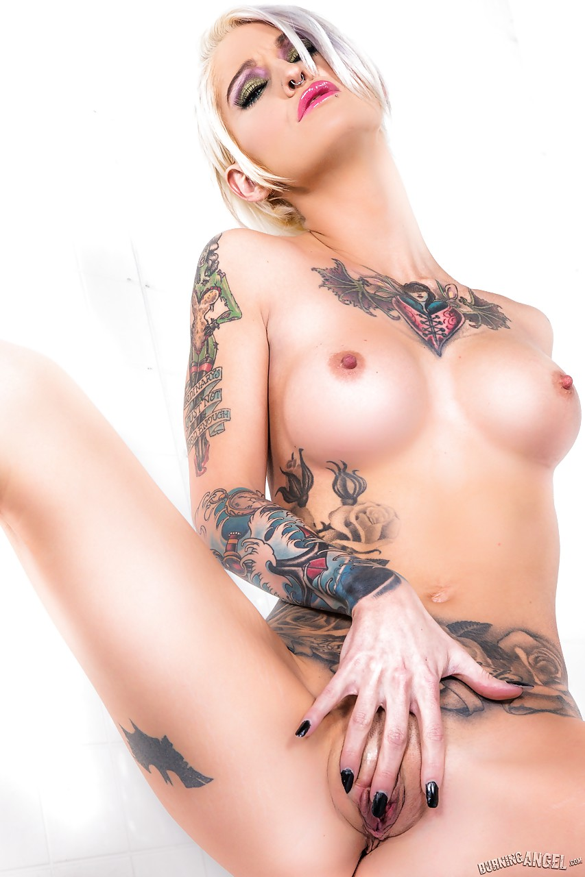Heavily inked blonde model Kleio Valentien striking sexy nude poses