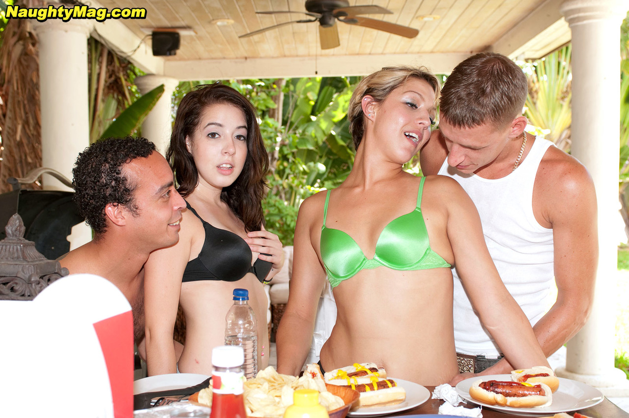 ... Allison Banks & Aliha Aldamen feed themselves with meat poles at the  BBQ party ...