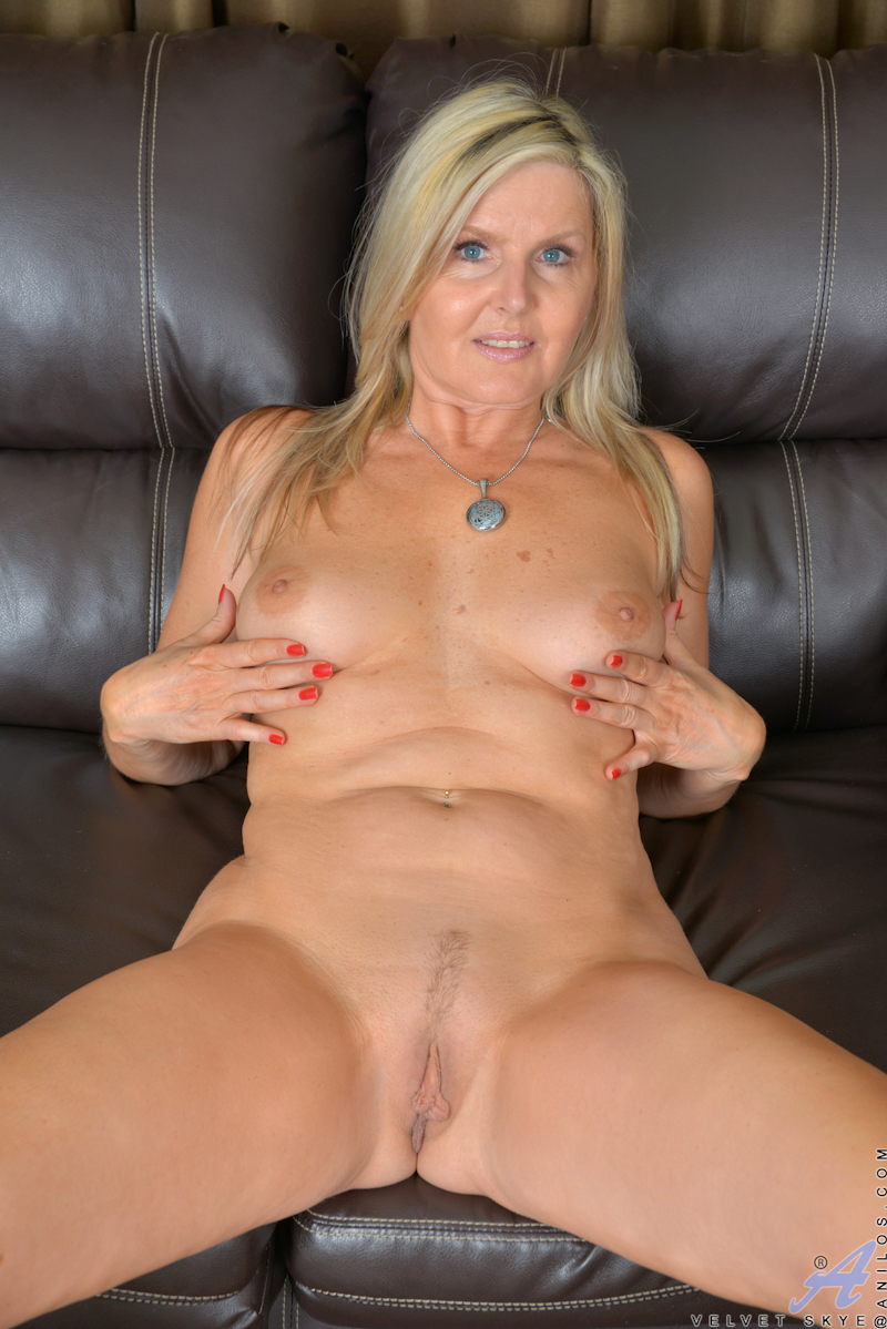 older blonde milf sheds sheer lingerie and lace panties to model