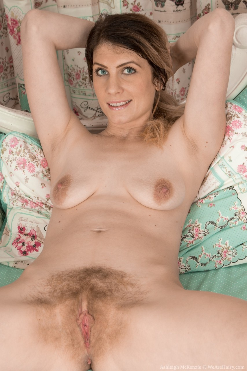 Hairy amateur Ashleigh McKenzie spreads her pussy lips after undressing