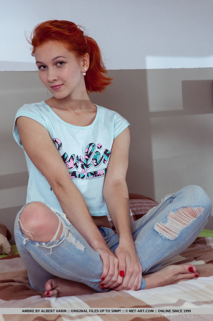 Redhead babe in ripped denim jeans revealing tiny breasts while undressing
