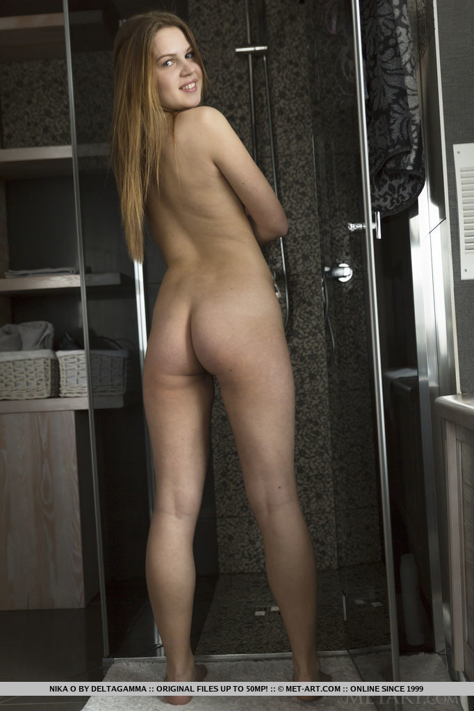 Teen babe Nika O flaunting small tits and tight ass in bathroom