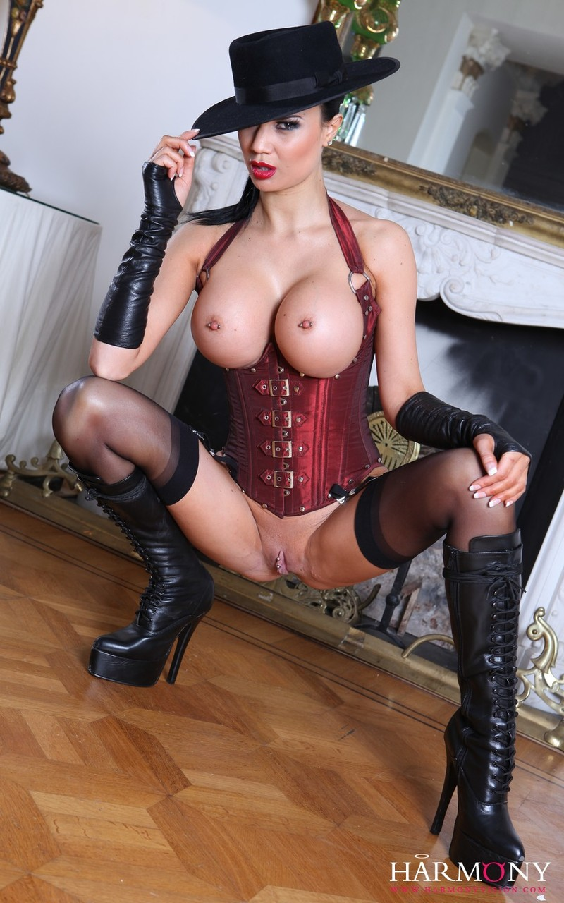 Busty flamboyant Jasmine Jae in boots rides one cock  sucks another in 3some
