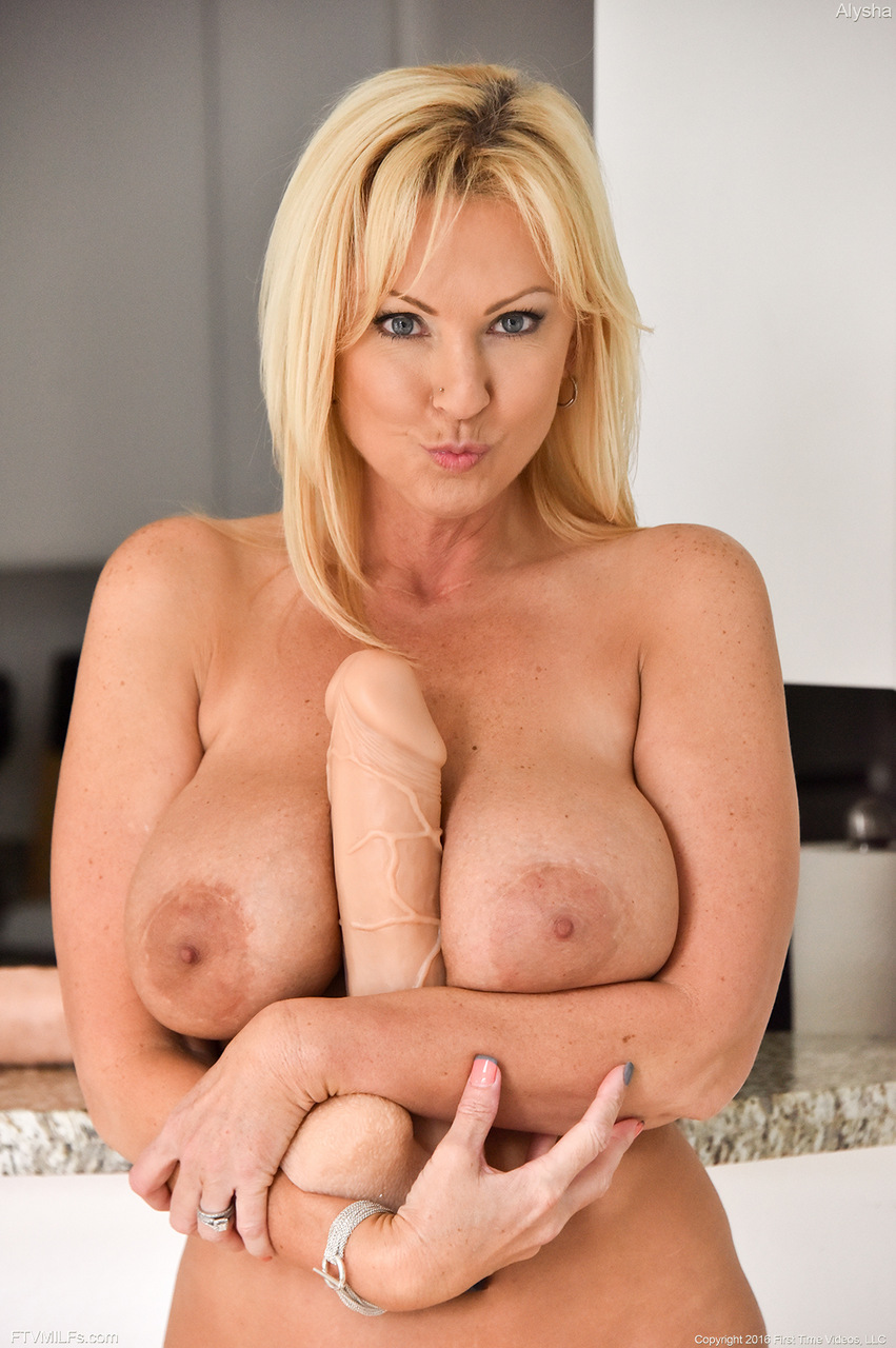 buxom blonde milf stretches cunt for huge dildo and bottle