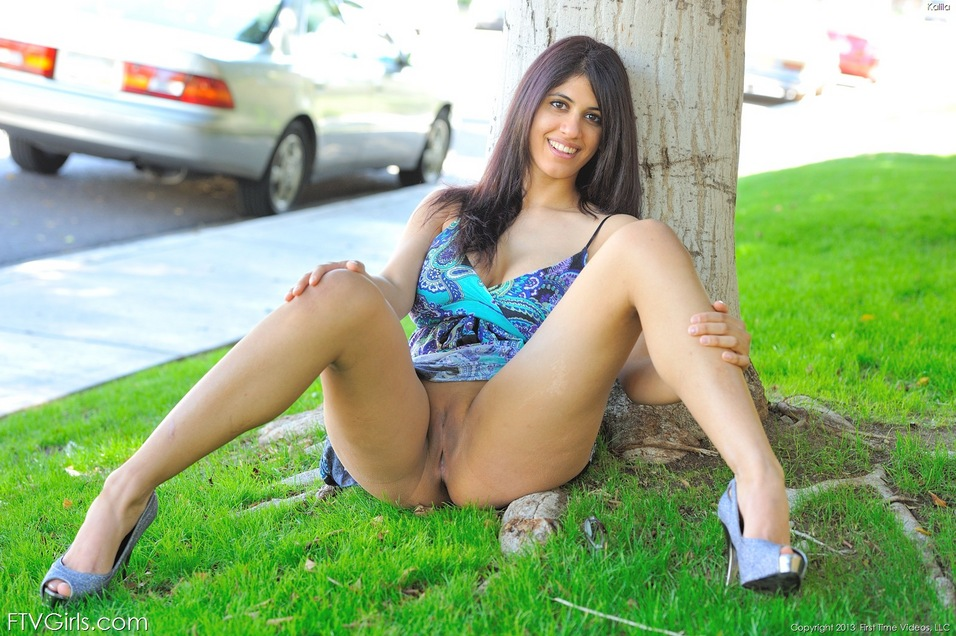 Bespectacled brunette babe with big tits undresses in public