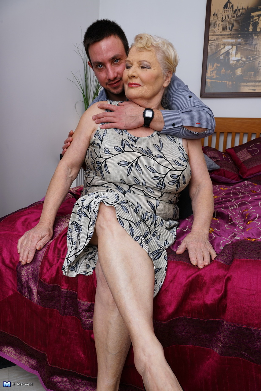 Obese Granny Undresses Her New Boy Toy For For A Pleasing Bedroom