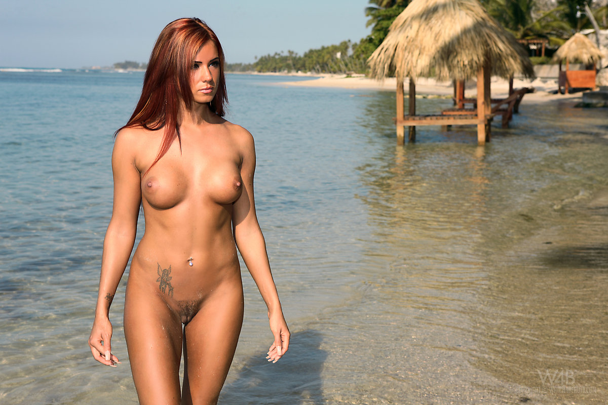 ... Beautiful female Ashley Bulgari poses naked on a nude beach ...