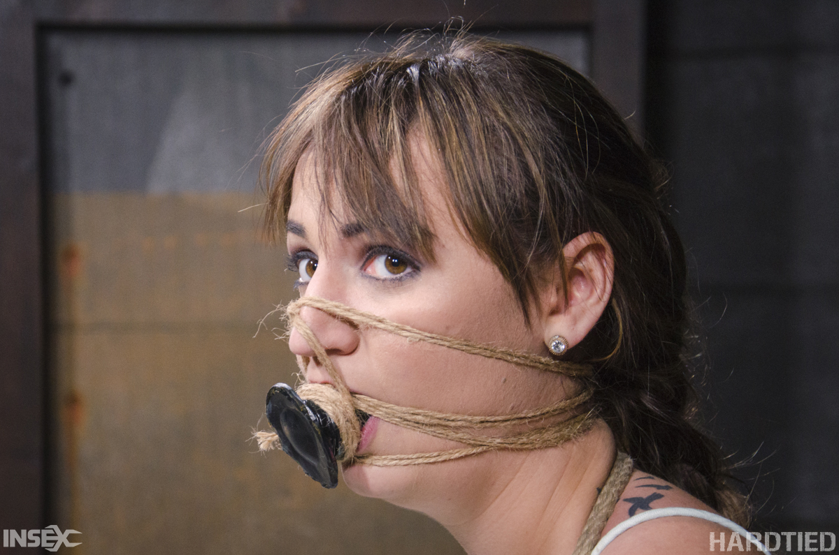 White girl Charlotte Cross screams in pain while restrained with course rope