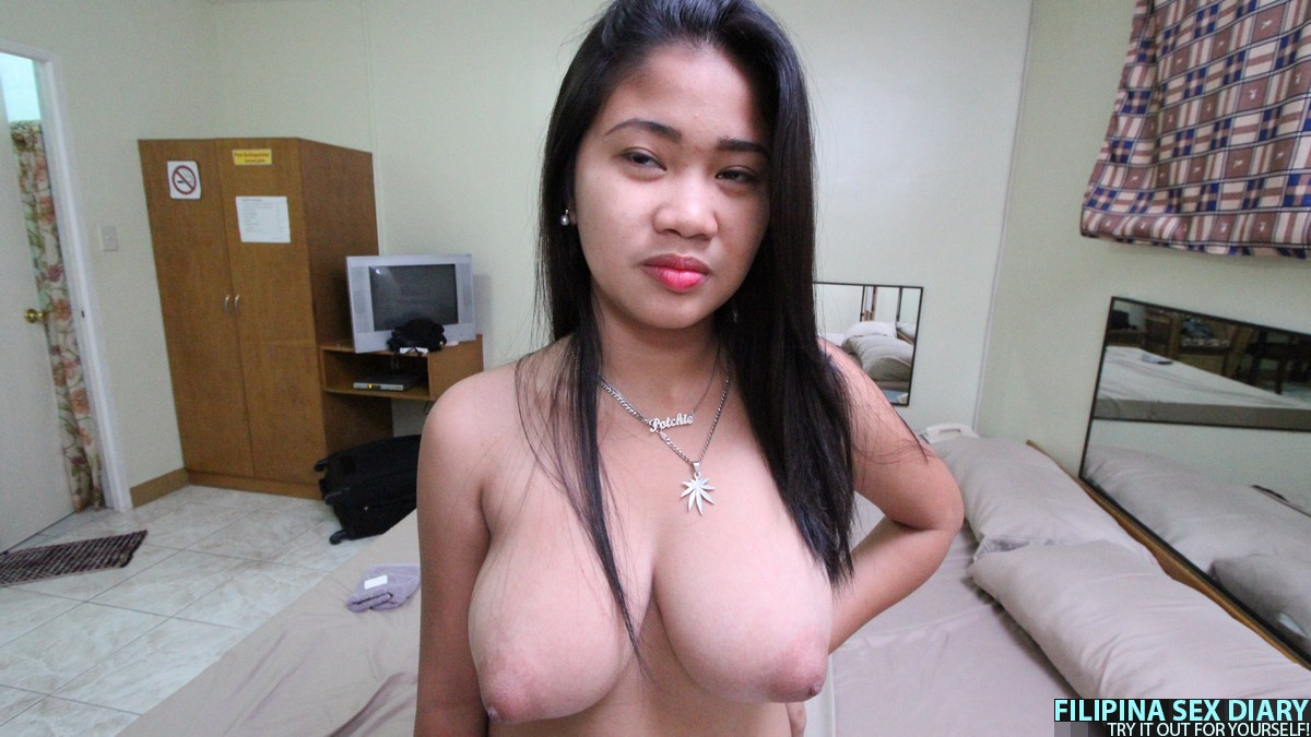 Big tits asian washing a guy in her apartment