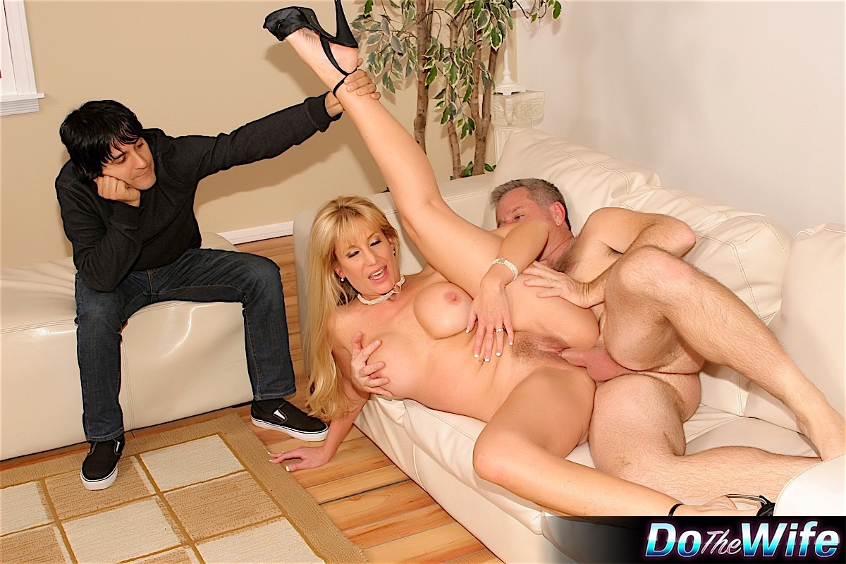 Busty blonde wife Olivia Parrish gets banged on a couch in ankle strap heels