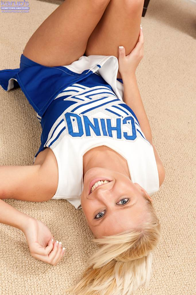 Young blond Krystal Paige frees firm tits and cotton panties from cheer outfit