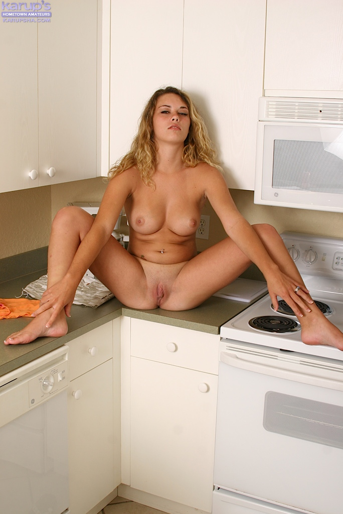 Cute first timer Traci undress for pussy play in her kitchen