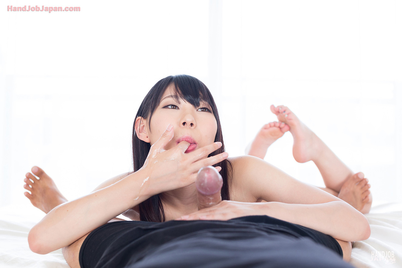 Japanese girl teases with no panty upskirt before giving a POV handjob
