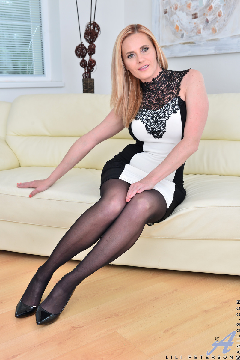 older housewife in black stockings revealing big boobs and meaty